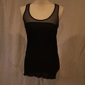 GA1) A new and never worn before black top w/ lace